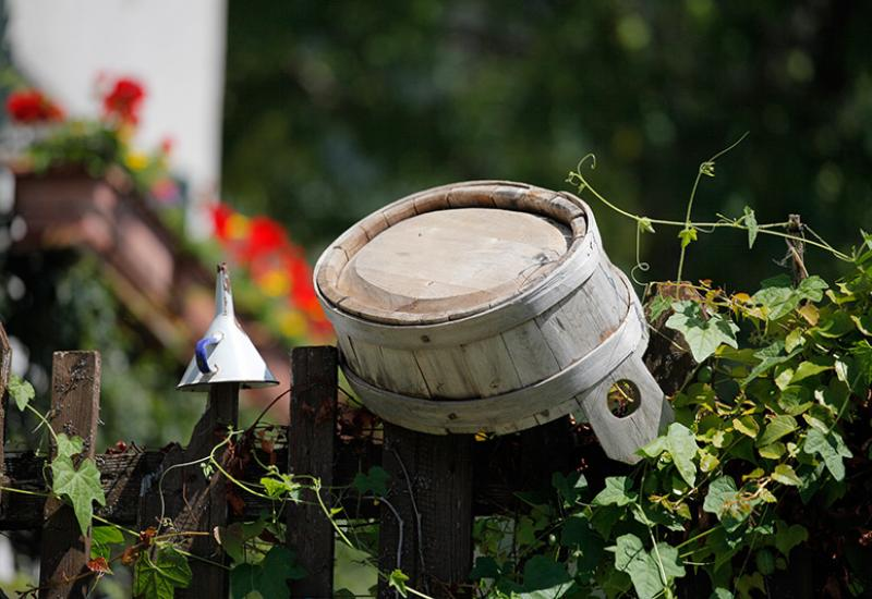 wooden bucket on the fence